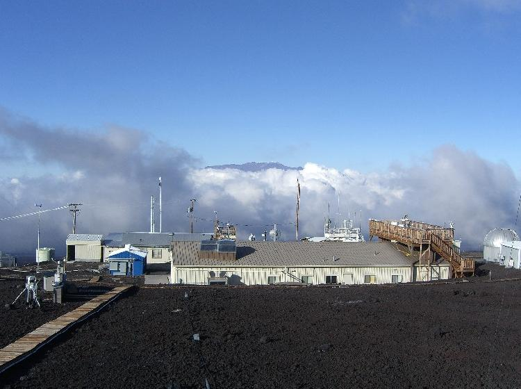 Clouds rise up toward the Mauna Loa Observatory.